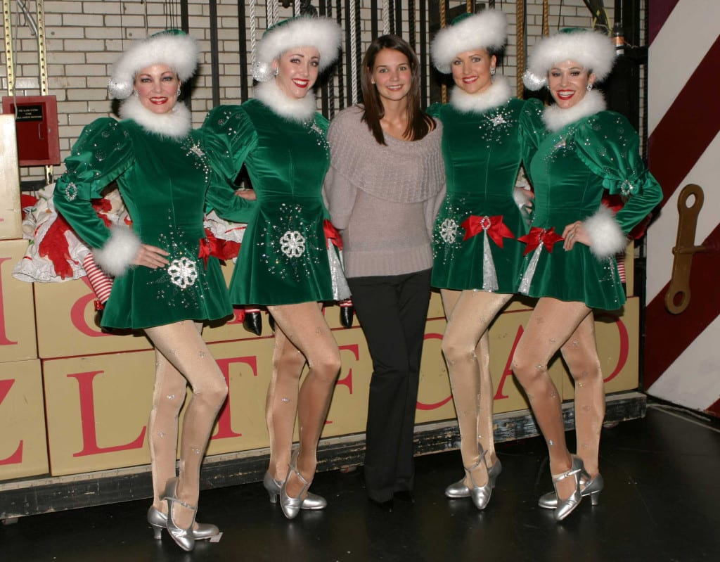 Longtime fan Katie Holmes posing backstage with four Rockettes