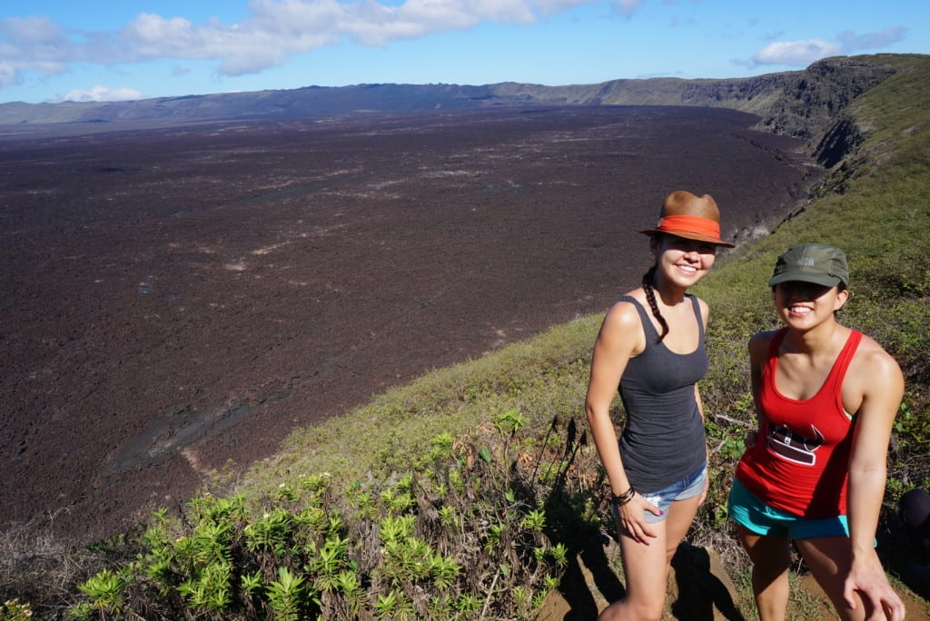 Rockette Christine (left) and Stephanie hiking the Sierra Negra Volcano in Isla Isabella