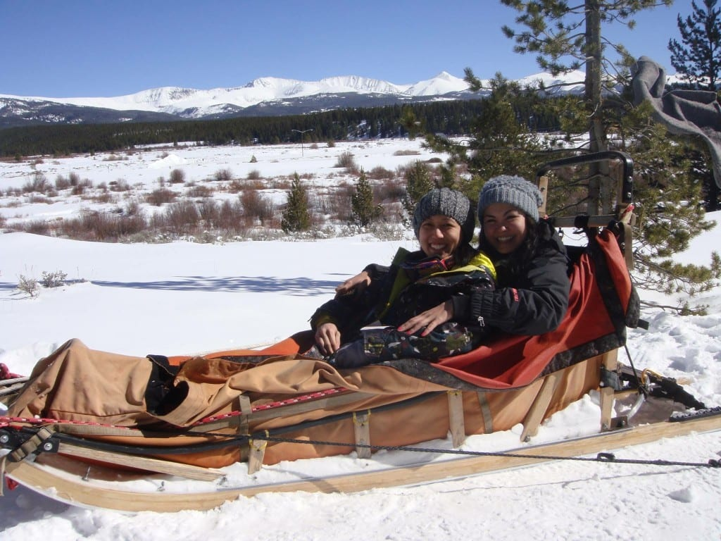 Rockette Christine (right) and Stephanie dog sledding at Beaver Creek in Colorado