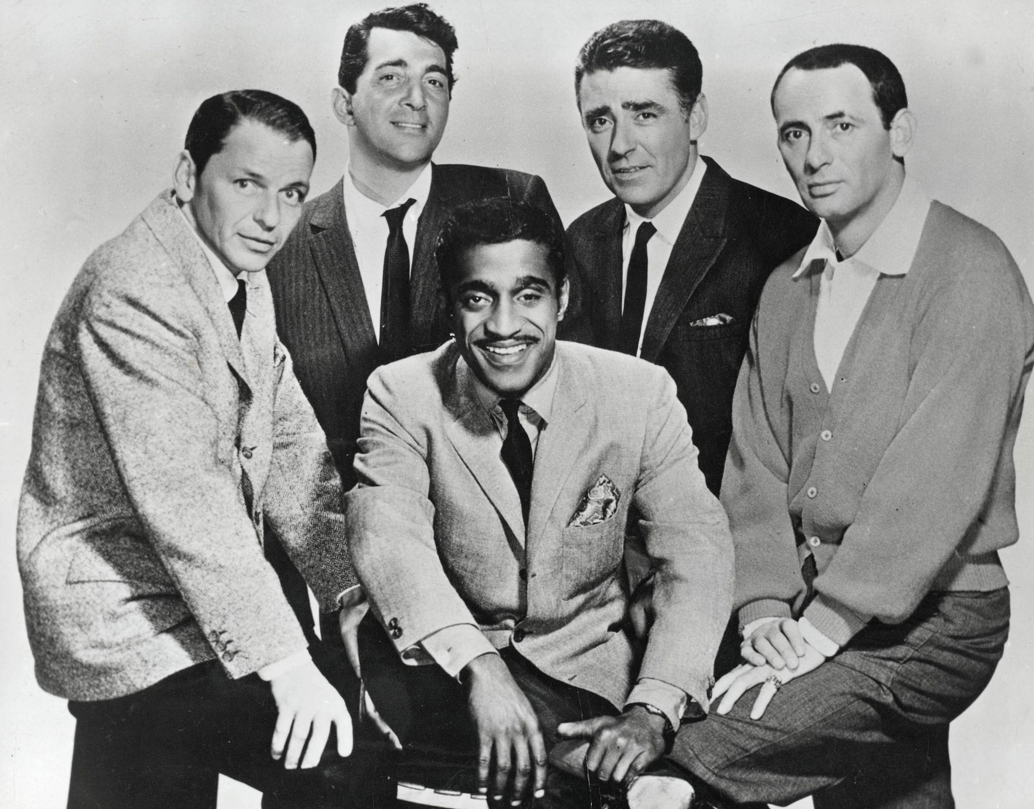 The Rat Pack (Frank Sinatra, Dean Martin, Sammy Davis Junior, Peter Lawford and Joey Bishop) pose for a photo in August 1960. [Photo Credit: Popperfoto | Getty Images]
