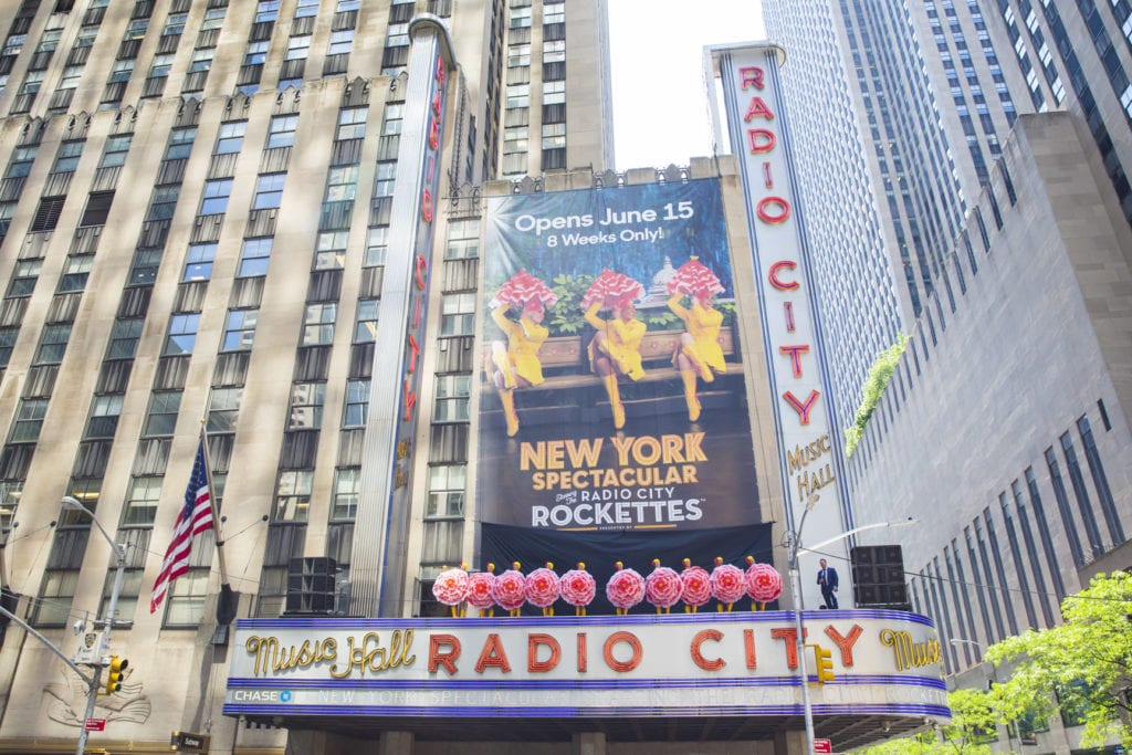 June 7, 2016: The Radio City Rockettes perform on top of the marquee at Radio City Music Hall to promote the upcoming production of the New York Spectacular this summer.